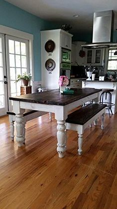 """6 Foot heart pine table set. 6 foot antique heart pine in a distressed walnut finish. Comes with 5.5"""" chunky, turned legs and 2 matching benches. Can be done in a multitude of colors/stains."""