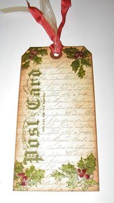 Love her simple take on Tim Holtz's 12 Tags of Christmas; and love her Disney Layouts too.