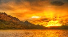 I had a late night of decadent chocolate at a great local haunt there in Queenstown. I ended up staying later than I expected because of said decadence. This meant I arrived back over to my rental house in Kelvin Heights as the sun was finishing its descent. - Queenstown, New Zealand - Photo from #treyratcliff Trey Ratcliff at http://www.StuckInCustoms.com