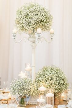 Look at these stunning centrepieces. #whiteweddings