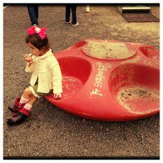 Girl sitting on disk