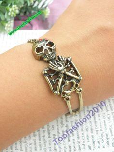 Pretty retro copper pirate human bone skull rib cadre hand chain bracelet pendant jewelry punk style. $5.99, via Etsy.