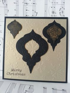 Christmas card black and gold-heirloom bauble 2010, some texture embossing and some gilding wax