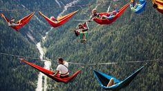 A photo made available on Sept. 8, 2014 shows extreme athletes resting in hammocks on webbings stretched between rocks during the International Highline Meeting in Monte Piana, near Misurina, in the northern Italian Alps.