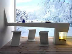 The amazing Warmpath will fit aptly in any Scandinavian home. The flowing white Corian surfaced table married to the fireplace…they both look so warm and cozy together! How long will this marriage last? Don't know, but let's enjoy it till it's warm….