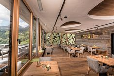 Pleasant atmosphere in this beautiful dining area at Bergwiesenglück in Tyrol with our Oak Lapis FLOORs and ACOUSTIC elements and reclaimed wood panels in sunbaked grey Dining Area, Dining Table, Ad Home, Hotel Interiors, Wood Paneling, Table And Chairs, Acoustic, Floors, Grey
