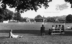 Godstone, The Village Green c.1955. This tranquil scene, with a cricket match in full swing on the village green, looks towards the south side of the green; the A22 is on the far left beyond the trees. #Godstone