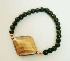 Copper and olive bead stretchy bracelet by AhrensGallery on Etsy