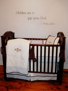 I love the simplicity of the monogram and of the simple Bible verse above the crib.