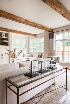 A Rustic, Yet Refined Home In River Oaks   Interior Design by Marie Flanigan of Marie Flanigan Interiors   Photography by Julie Soefer   Modern Sanctuary   Living Room   Glamorous Living Room   Details and Accessories   Windows   Seating