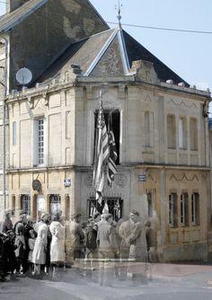 Trévières, Rue Octave Mirbeau. L'office notarial de Trévières, etude de Maître Charles Pommier, notaire et maire de Trévières, est décorée des drapeaux français et alliés pour 'Independece Day', 4 juillet 1944.