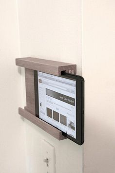 iPad Wall Holder Add it to your favorites to revisit it later. Small Wood Projects, Home Projects, Ipad Wall Mount, Tablet Mount, Bike Wall, Ipad Holder, Tablet Holder, Ipad Stand, Home Automation