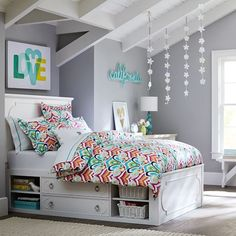 we love a bed with lots of storage! // ps - how chic are these grey walls with bright floral bedding for spring?