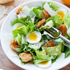 chopped egg caesar salad with hash brown croutons.