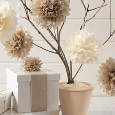 What about some Easy+Tissue+Paper+Pom+Poms for centerpieces? Cheap, Easy, and Fast!