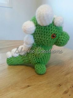 Check out this item in my Etsy shop https://www.etsy.com/listing/211482883/spiky-dragon-amigurumi-toy