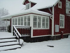 lovely windows & porch @ Swedish home.. essential for taking off and storing winter coats & boots