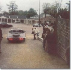 Elvis driving out of Graceland