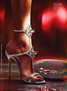 Studded leather sandal by Christian Louboutin in ELLE US December 2011 editorial