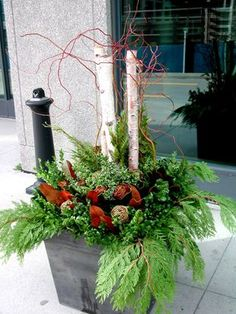 White, gold, green and brown materials extend a winter planter beyond the festive season. Christmas Planters, Christmas Porch, Noel Christmas, Outdoor Christmas Decorations, All Things Christmas, Christmas Wreaths, Christmas Crafts, Holiday Decor, Birch Decorations