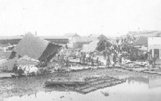 Duncan street scene after the cyclone of April 30, about 1898. Crowd of men surveying the destruction of several buildings. Western History Collections, University of Oklahoma Libraries, Irwin Brothers Studio Collection, Early Scenes