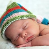 cute baby wearing a hat and sleeping