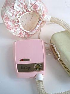 Portable hair dryer...with plastic bonnet.