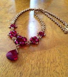 Elegant ruby Red statement necklace marsala by AmyKanarekDesignsThis stand-out stunning necklace makes a statement in ruby red that is subtle yet captivating! I have woven it using a red carpet worthy ruby red crystal teardFree pattern for necklace T Bold Necklace, Garnet Necklace, Diy Necklace, Necklace Designs, Crystal Necklace, Beaded Earrings, Ruby Jewelry, Bead Jewellery, Statement Jewelry