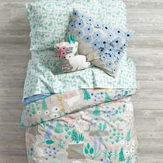 Deep in a mystical forest, we heard tales of a nature kids bedding set featuring a colorful, printed woodland scene complete with animals, flowers and more. Kids Bedding Sets, Toddler Bedding Girl, Girl Bedding, Toddler Rooms, Little Girls Bedding Sets, Cozy Bed, Little Girl Rooms, Boy Rooms, Kid Spaces