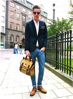 Shop this look for $319:  http://lookastic.com/men/looks/jeans-and-boots-and-socks-and-blazer-and-longsleeve-shirt-and-pocket-square-and-belt-and-briefcase/382  — Blue Jeans  — Walnut Leather Boots  — Blue Socks  — Navy Blazer  — White Longsleeve Shirt  — Multi colored Pocket Square  — Brown Leather Belt  — Tan Briefcase