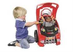 """This Mechanic's Car Engine will keep kids tinkering for hours. The 27"""" tall play set has lots of removable parts for pretend service, including the air filter, spark plugs, tires, radiator, struts, oil dipstick, and brakes, plus all the tools needed to get the job done. When the work is complete, you can shut the hood, get behind the wheel, and turn the key—the engine play set has electronic sounds for the ignition and horn, plus light-up headlights and turn signals."""