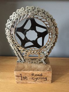 Harri's homemade cycling trophy for school. Made from old bike parts.