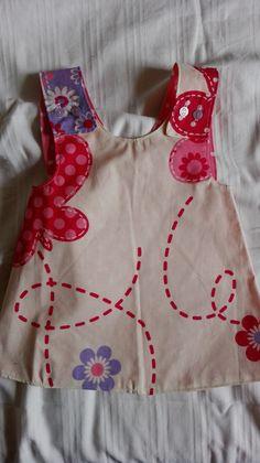 Schuerzenkleid rosa Schmetterling