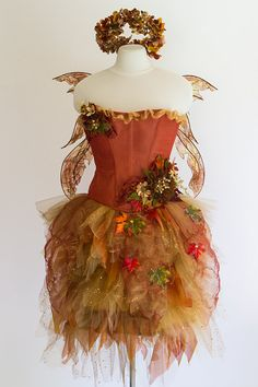 Like the beautiful, ornate detail in the fiery fallen autumn leaves, this four-piece costume (corset, tutu, wings and headpiece) is truly