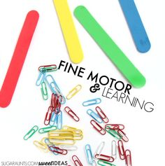 Fine motor color matching and math activity using paper clips and foam craft sticks.