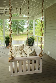 Designer Phoebe Howard used a porch swing from Ballard Designs and fabric from Sunbrella at the 2013 Southern Living Idea House.
