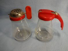 Red Top Glass Syrup Pitcher & Nut Grinder
