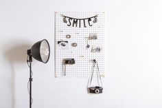Keep yourself organised with our Painted White Pegboard. The storage board comes in a variety of sizes. All boards contain a selection of wooden pegboard pegs in lots of great colours. Our minimal design looks brilliant when holding your tools, stationery and accessories. It is also perfect as a design mood board in your studio or workspace.