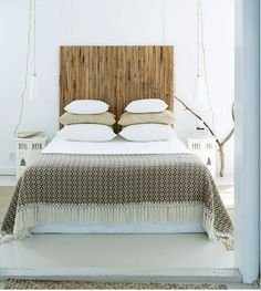 white + rattan: bamboo Ikea screen as a headboard for the master bed