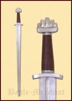 Wikingerschwert - schaukampftauglich    Dieses schöne Schaukampfschwert hat die typische Form eines Wikingerschwertes: eine kurze, stabile Klinge, ein kurzes Parier und einen massiven Knauf für die perfekte Balance. Armourclass ist eine der führenden und renomiertesten Schwertschmieden Großbritaniens. Ihr exzelleneter Ruf eilt diesen Schwertern weit voraus. Die Schwerter sind daher extrem begehrt und die Stückzahlen sind sehr begrenzt. Wartezeiten von 6 Monaten sind keine Seltenheit.  Bei…