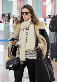 #alessandraambrosio spotted at #barcelona airport on March 18, 2016. carrying #saintlaurent Striped Canvas Tote and #Chanel Crossbody bag. from @alessandraambrosio_inspiration's closet #saintlaurent
