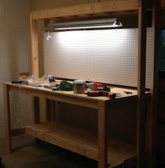 Here is the finished project with our nice bright light and pegboard installed to hang our tools