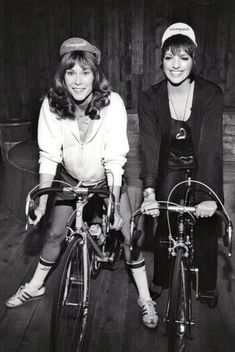 Kate Jackson and Liza Minnelli ride bikes, wear Campy casquettes.