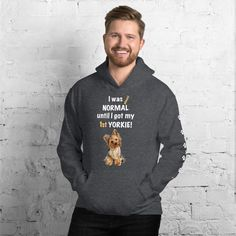 A new hoodie for Yorkshire Terrier dad and parent from our clothing collection, Almost normal, with white paw prints on the left sleeve.