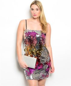 Abstract Sequin Dress - This cool dress has many faces. It can be worn out clubbing or on a date. Dress it up for a wedding or office party. It has a contrasting black back and spaghetti straps. Pair it with the black sequin shrug to make the abstract pattern come to life. #plussizedresses