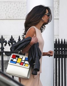 Amal Clooney wears a neutral look by Stella McCartney, leather jacket, and bag by Les Petits Joueurs Amal Clooney, George Clooney, Stylish Street Style, Sweater Set, Work Fashion, Women's Fashion, Travel Fashion, Spring Fashion, Fashion Design
