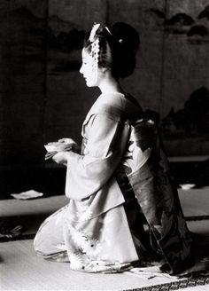 A maiko at a tea ceremony in Kyoto. Circa 1950-1970.