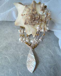 "boxer mom65:"" Shell cascade earrings"" dg designs: ""Sea shells & sea urchins lampwork necklace"" Jellybug artworks: ""Sea shell twist ne..."