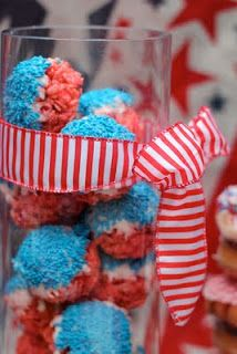 Displayed rice crispy treats in a tall glass vase and add a splash of stripped ribbon