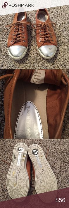 Michael Kors leather sneakers Chestnut leather with silver toes and silver strips at back of heels. Leather shoelaces. Slight scratches on toes that could not be captured in the picture and are not noticeable when worn. Great condition;hardly worn. Michael Kors Shoes Athletic Shoes